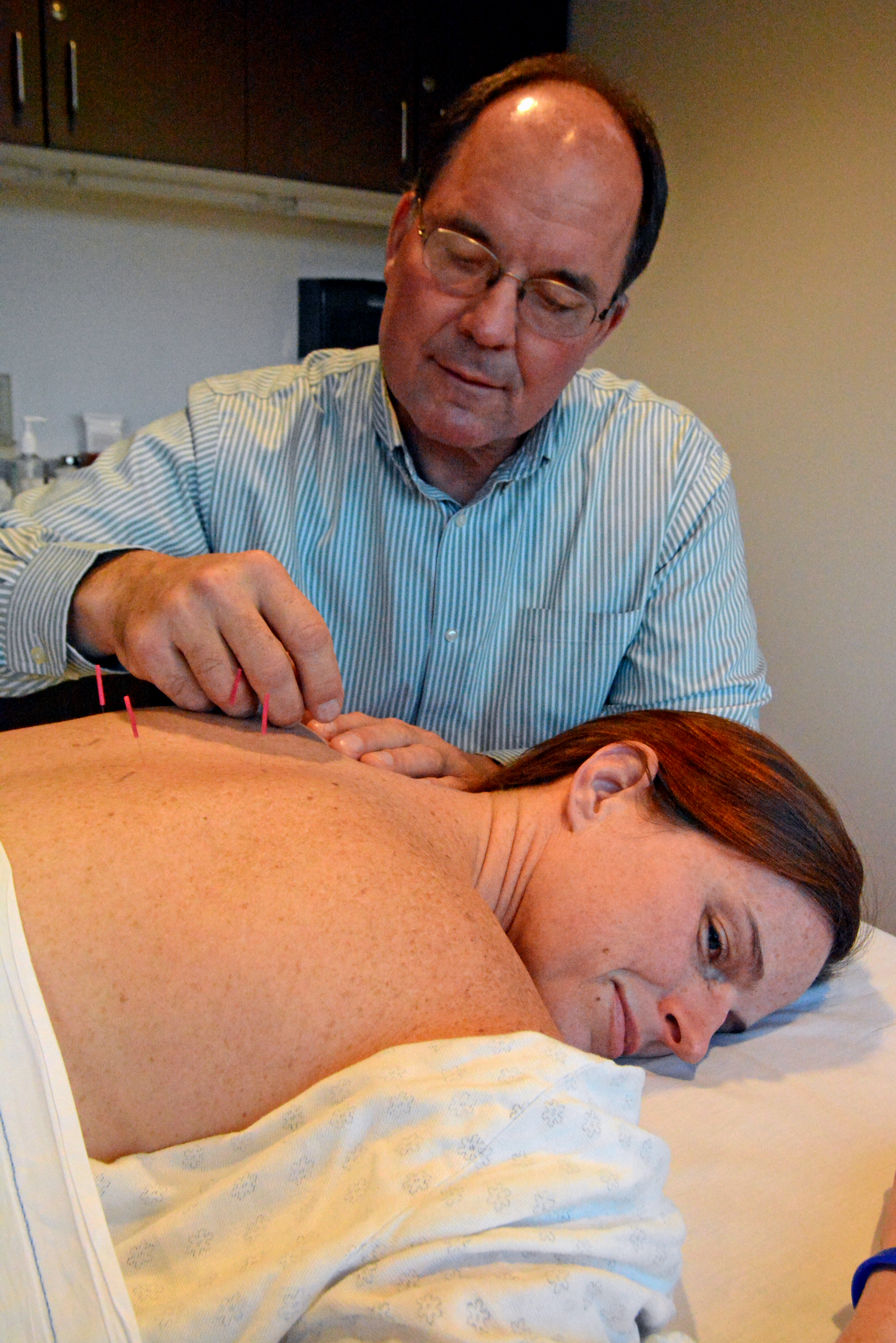 A patient is receiving acupuncture treatment from a Winchester Hospital acupuncturists